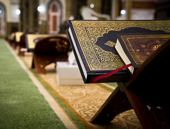 What benefits are derived from reading the English or transliteration of the Quran?